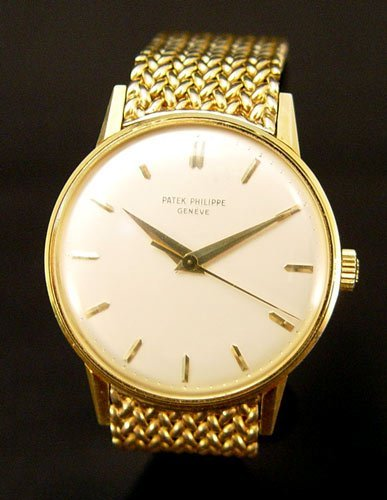 51: PATEK PHILIPPE 18k GOLD WRISTWATCH & 18K Band