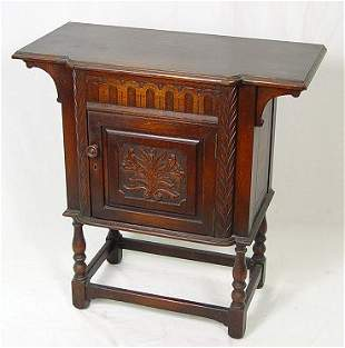 JACOBEAN REVIVAL CARVED OAK STAND BY H. KRUG