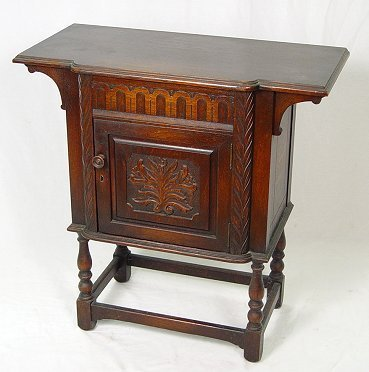 7: JACOBEAN REVIVAL CARVED OAK STAND BY H. KRUG