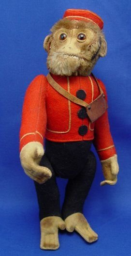 002: VINTAGE SHUCO YES NO BELL HOP MONKEY TOY