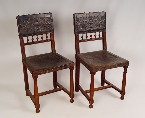 16: 2 EARLY SPANISH CARVED AND LEATHER BOUND CHAIRS