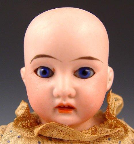 2011A: ARMAND MARSEILLE BISQUE HEAD DOLL