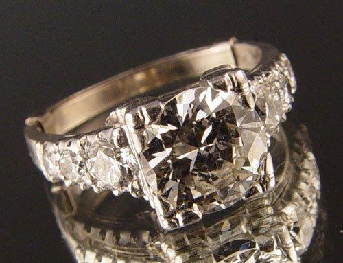 23: PLATINUM &  DIAMOND  WEDDING RING  1.25 ct. sz5