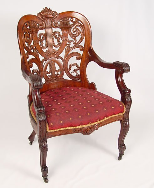 1016: GEORGE HENKELS CARVED & LAMINATED ARM CHAIR