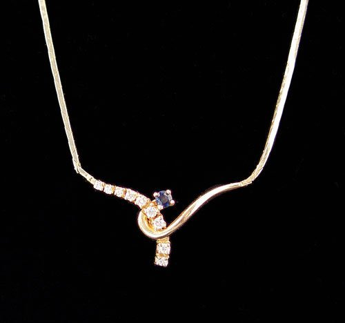 720: 14K GOLD, SAPPHIRE & DIAMOND NECKLACE 8 grams