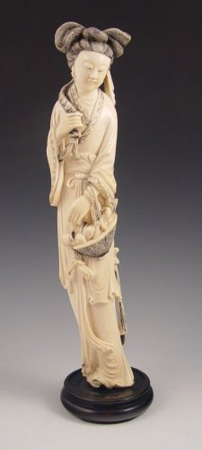 1006: CHINESE CARVED IVORY WOMAN WITH BASKET