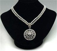 DIAMOND PENDANT ON MIKIMOTO PEARL NECKLACE