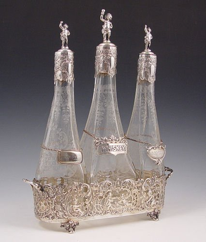 1002: RETICULATED STERLING TANTALUS W/ ETCHED DECANTERS