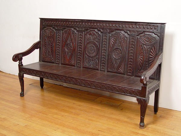 1016: 19TH C ENGLISH CARVED PANEL SETTLE