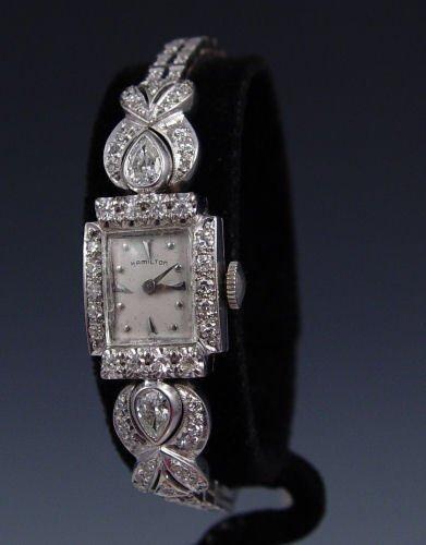 1002: 14k LADY HAMILTON DIAMOND encrusted  WRISTWATCH