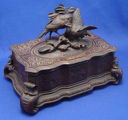 1002: 19th C CARVED BIRD SWISS MUSIC BOX