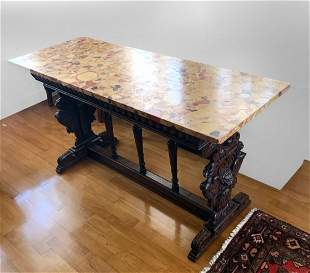 HEAVILY CARVED EGYPTIAN REVIVAL LIBRARY/TRESTLE TABLE