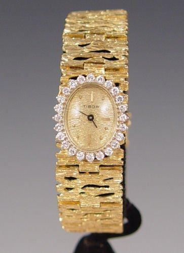 17: 55 GR 1CTW DIAMOND 14k GOLD TIBOR LADIES WATCH