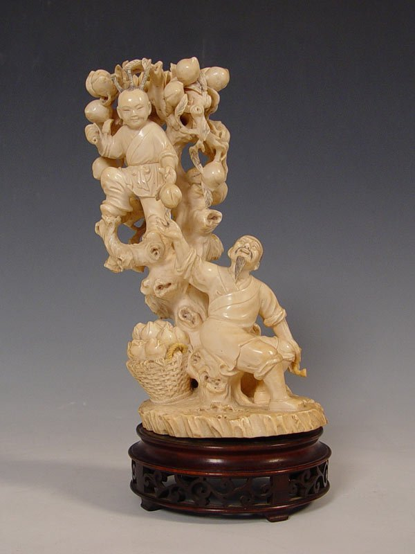 51: LARGE CARVED IVORY FIGURAL GROUP
