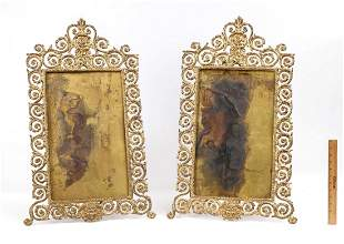 PAIR OF BRASS ORNATE FRAMES WITH MASQUERON