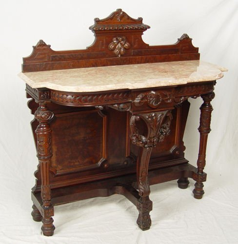 21: HIGH VICTORIAN CARVED WALNUT FOYER TABLE