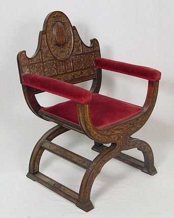 16: HEAVILY CARVED HERALDIC SAVONAROLA CHAIR