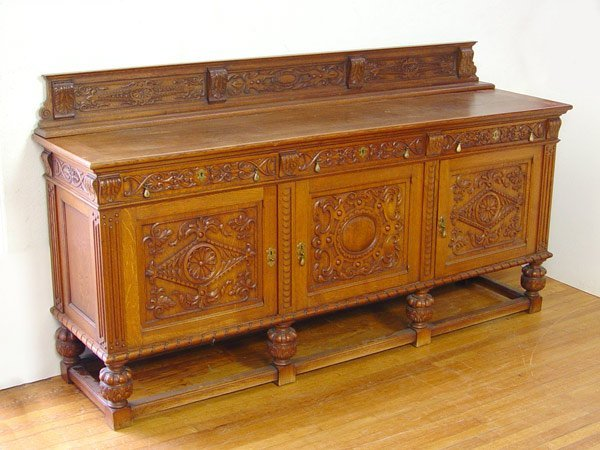 12:  VICTORIAN  CARVED OAK SIDEBOARD