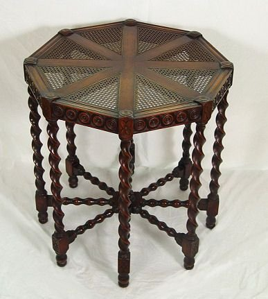 1025: CARVED MAHOGANY OCTAGONAL CANE TOP CENTER TABLE