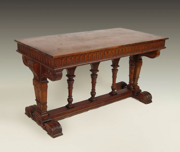 12: CARVED GOTHIC STYLE TRESTLE BASE LIBRARY TABLE