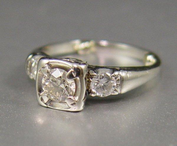 19: 3 STONE DIAMOND RING  14K  sz 5  .60 CTW