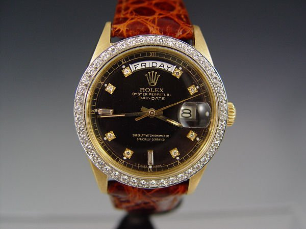 22A: 18K VINTAGE ROLEX CA. 1961 WATCH DIAMOND BEZEL