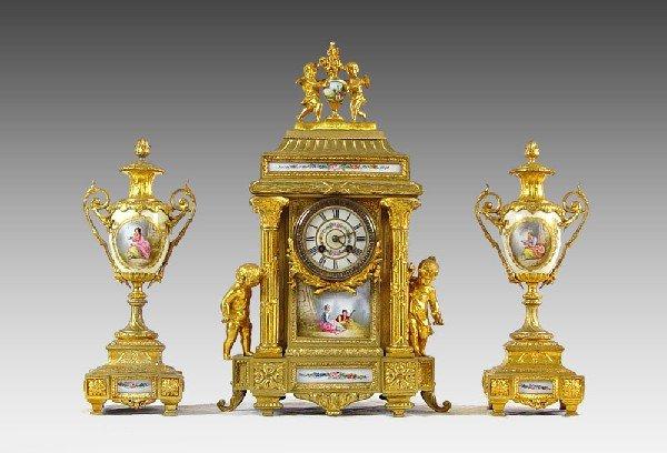 1: MASONIC PRESENTED CHERUB FIGURAL CLOCK GARNITURE