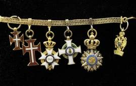 53 18K CHAIN WITH ENAMEL MINIATURE RUSSIAN MEDALS
