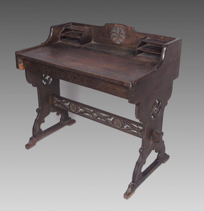 24: STYLE OF ROSE VALLEY CARVED WRITING TABLE: