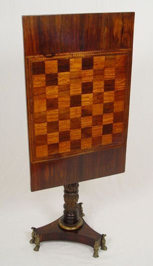 1014: AN EARLY PARQUETRY TILT TOP CHESS TABLE