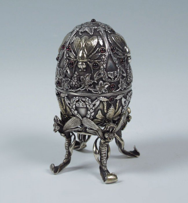 1: OVCHINNIKOV RUSSIAN SILVER AND GARNET FIGURAL EGG
