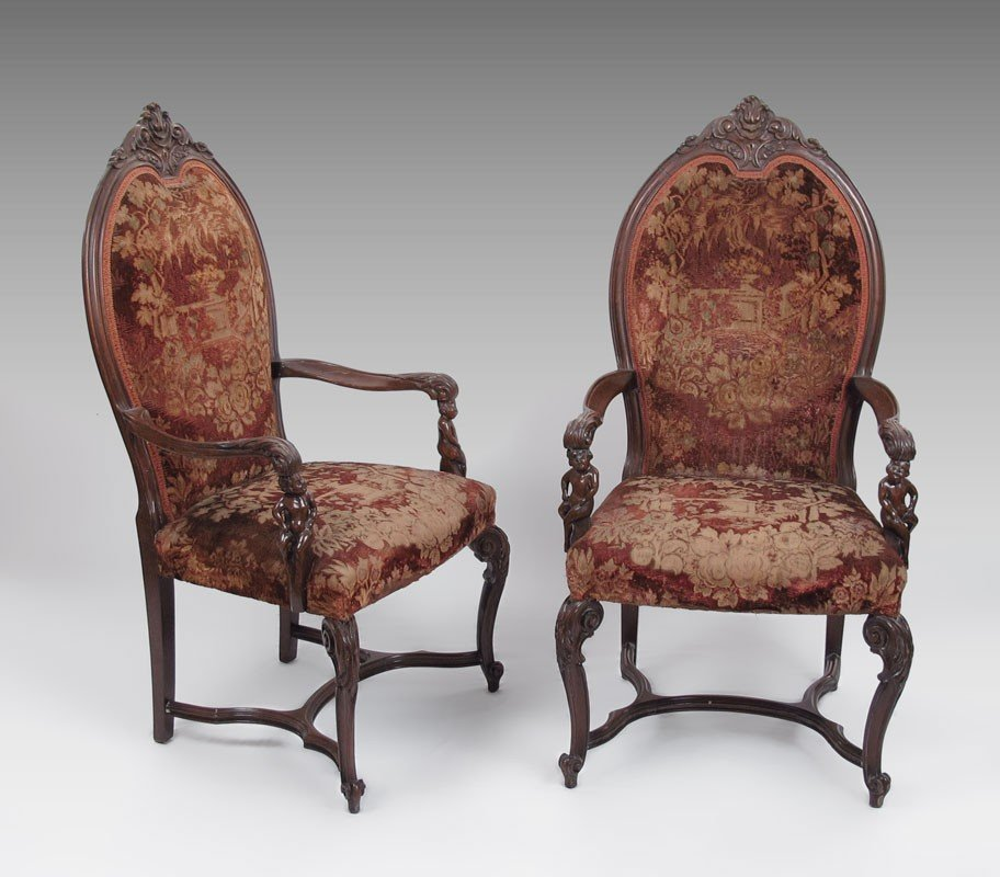 7: PAIR OF FIGURAL CARVED ARM CHAIRS