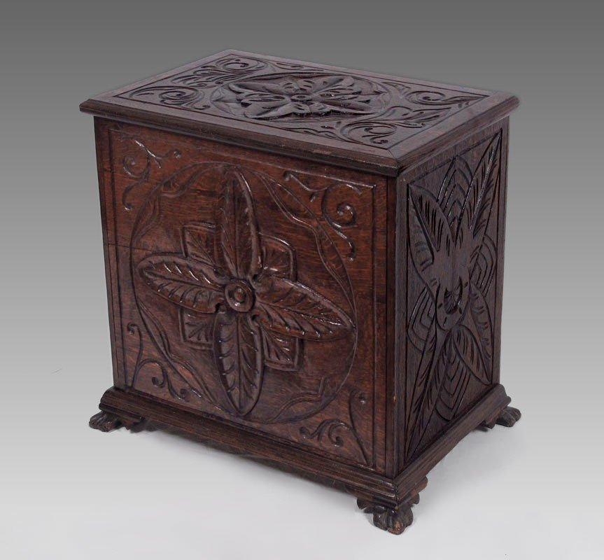 16: HEAVILY CARVED OAK LIFT TOP CHEST