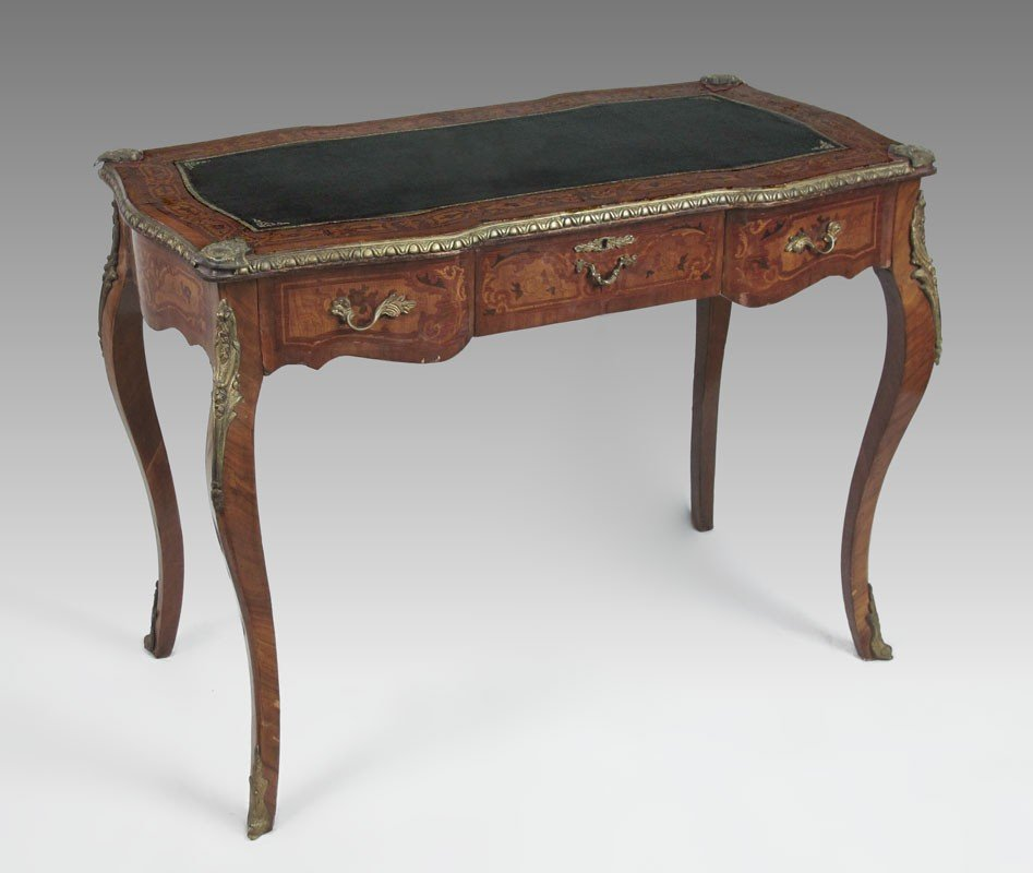 79: FRENCH ORMOLU LEATHER TOP WRITING TABLE