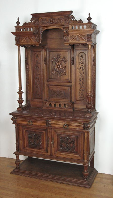 24: HEAVILY CARVED WALNUT BACKBAR WITH MARBLE TOP