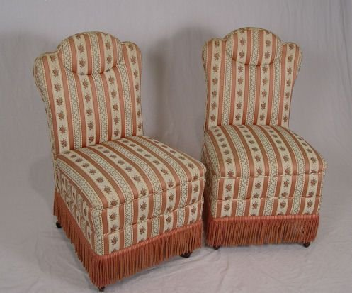 1013: PAIR OF FRINGED SLIPPER CHAIRS
