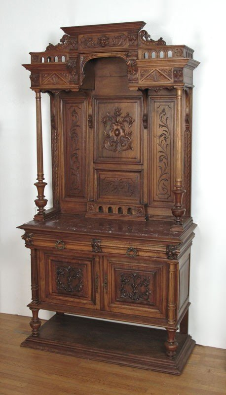 168: HEAVILY CARVED WALNUT BACKBAR WITH MARBLE TOP