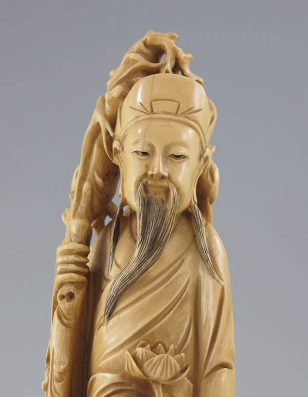 203: CARVED IVORY WISEMAN WITH CHILD - 2