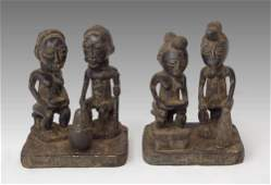 499 TWO AFRICAN CARVED WOOD BAULE SEATED ROYAL COUPLES