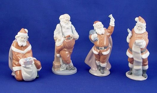 412: 4 LLADRO SANTA CLAUS RETIRED FIGURINES WITH BOXES