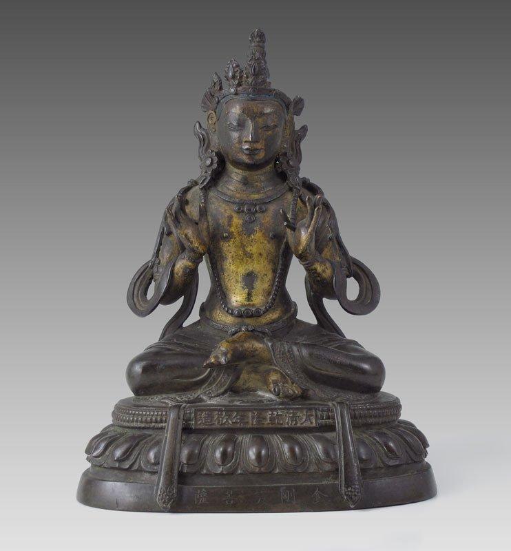 446: BRONZE TIBETAN SEATED BUDDHA