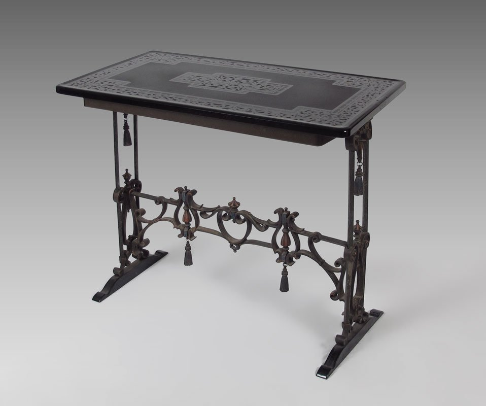 73: EARLY 20TH C WROUGHT IRON BLACK GLASS TOP TABLE