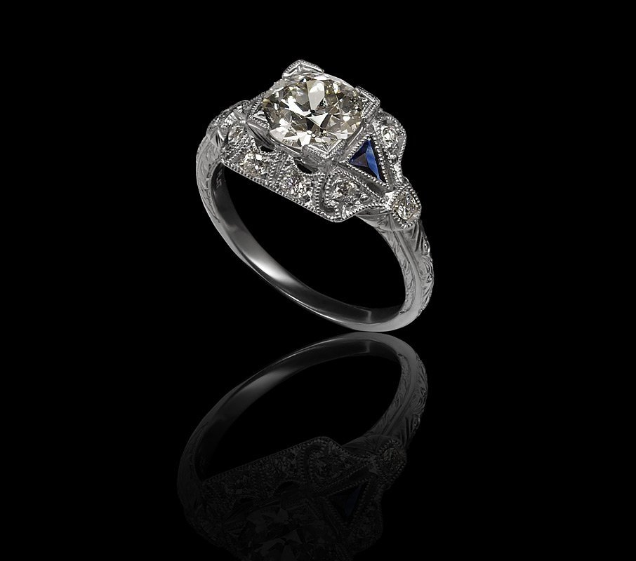 41: PLATINUM 1.3 CT OLD EURO DIAMOND & SAPPHIRE RING