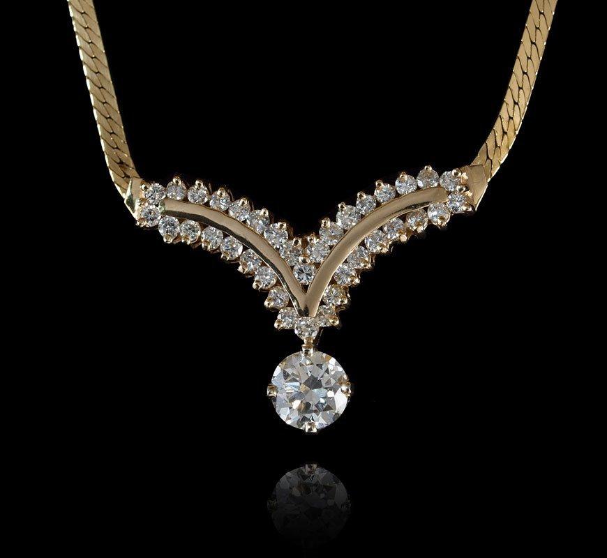 28: 14K GOLD 1.21 CT DIAMOND SOLITAIRE PLUS 1.10 CTW