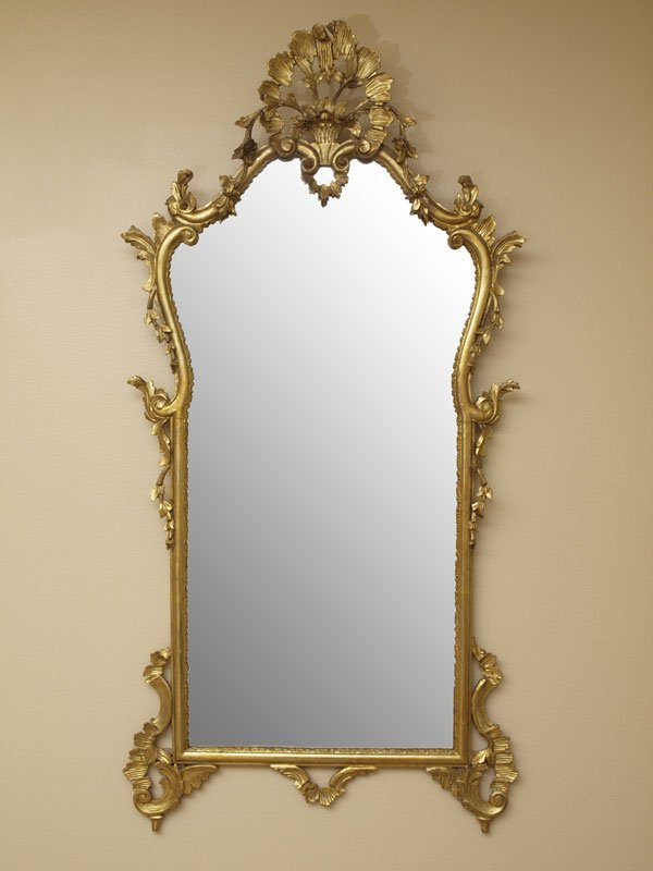 44A: ORNATE CARVED GILT WOOD MIRROR