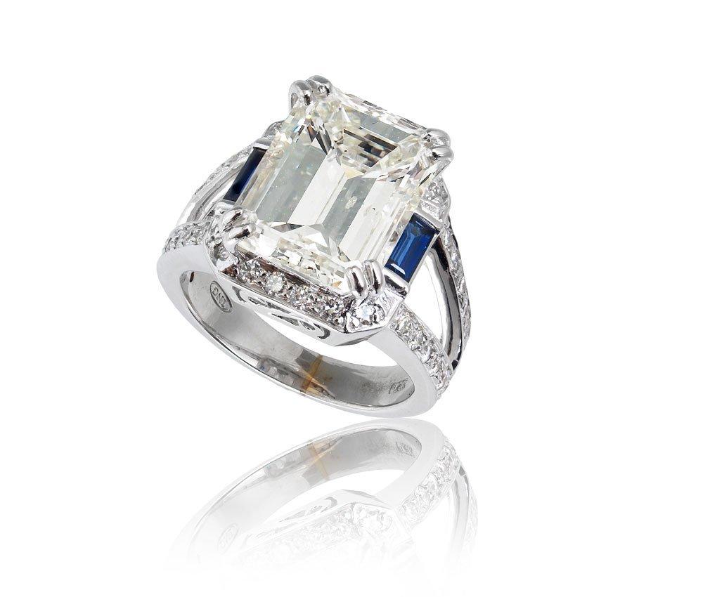 32: 6 CT EMERALD CUT CENTER  DIAMOND W/  SAPPHIRES 14K