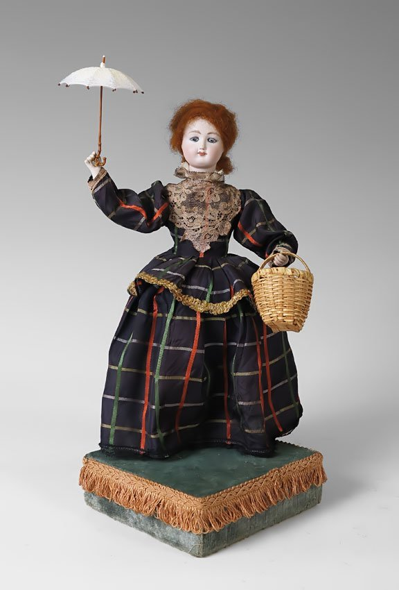 5: WIND UP MUSICAL AUTOMATON DOLL AND GLASS DOME