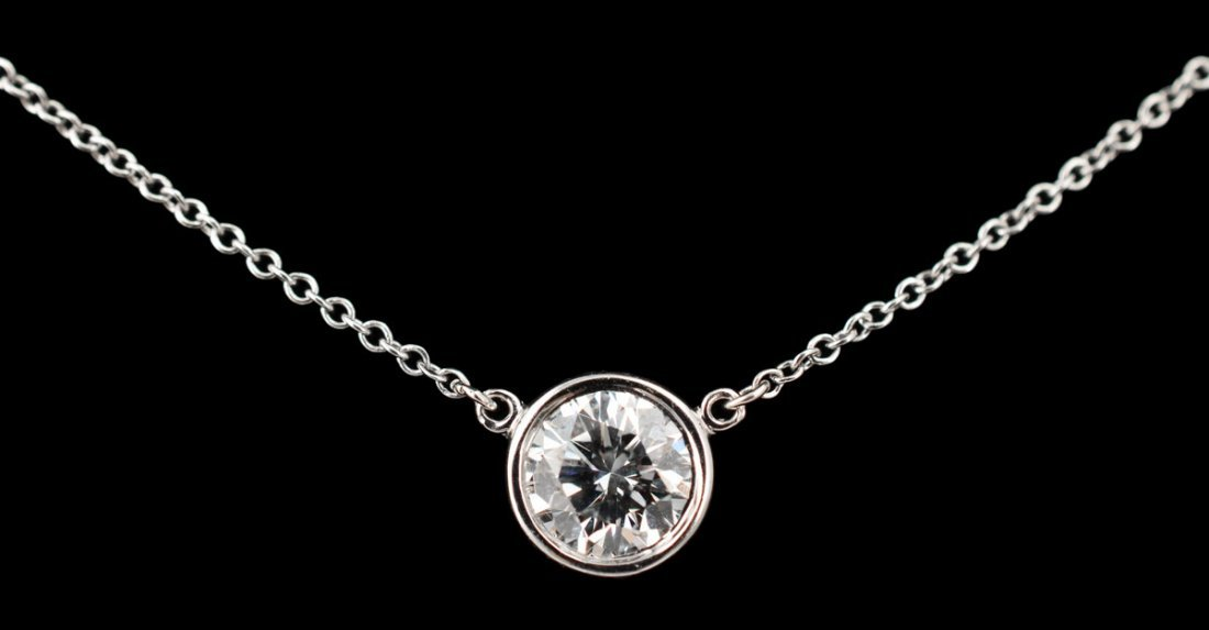 147: TIFFANY & CO .78 CT DIAMOND PENDANT NECKLACE