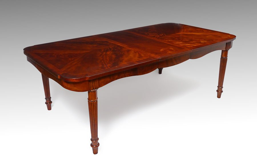 HIGHLY FIGURED MAHOGANY DINING TABLE