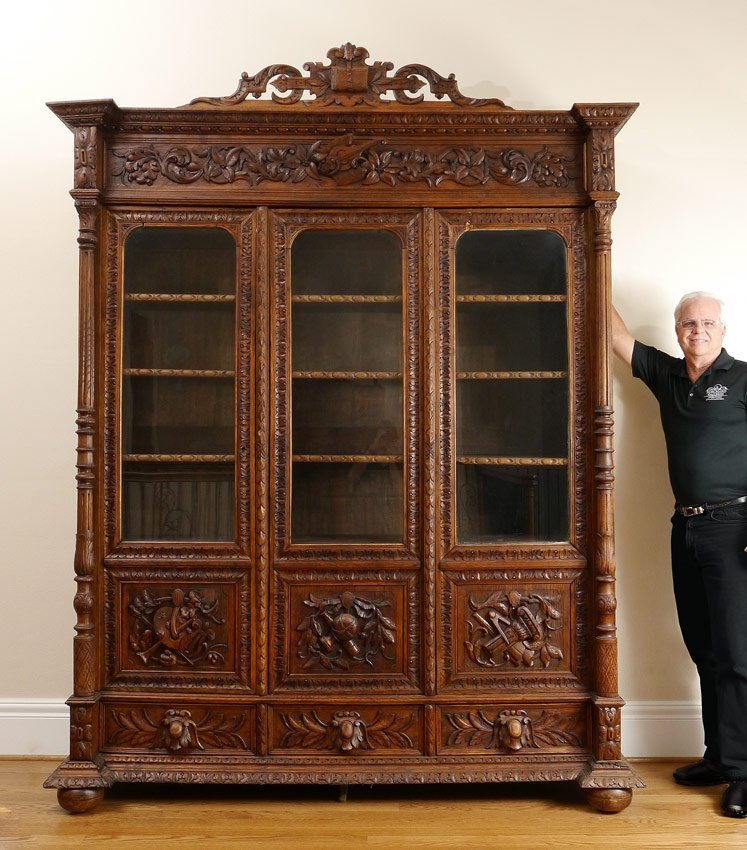 PROFUSELY CARVED RENAISSANCE REVIVAL BOOKCASE